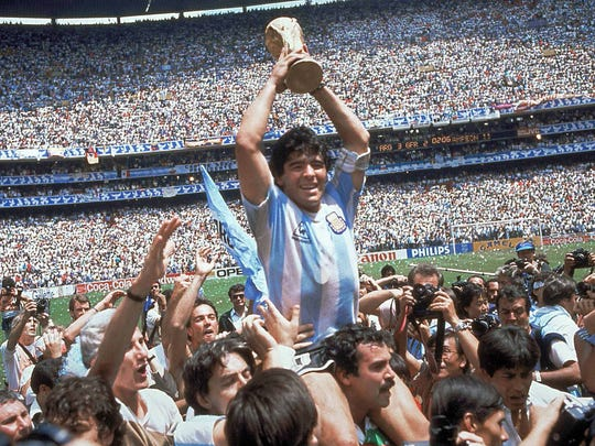 In this June 29, 1986 file photo Diego Maradona of Argentina celebrates with the cup at the end of the World Cup soccer final in the Atzeca Stadium, in Mexico City, Mexico.
