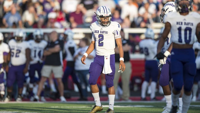 Ben Davis High School senior Reese Taylor (2) watches as the team lines up on offense during the first half of an IHSAA high school football game at Center Grove High School, Friday, September 8, 2017.