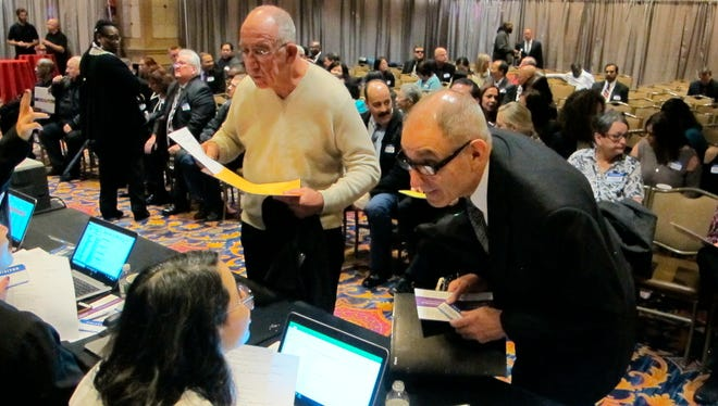 Job applicants interact with screening staff during a hiring event for the soon-to-open Hard Rock casino in Atlantic City, N.J.