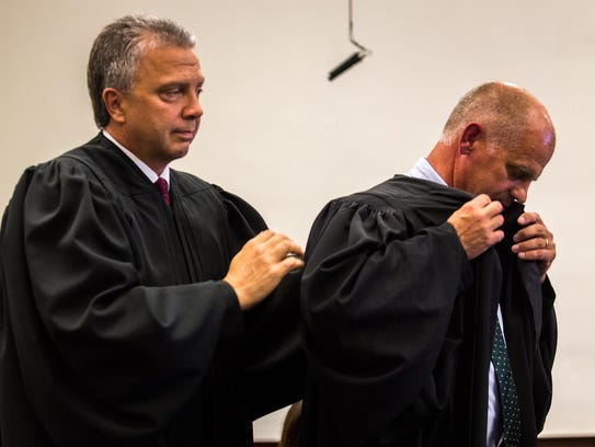 District Judge Dirk Sandefur helps newly appointed