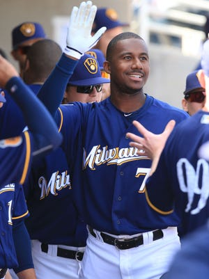 Brewers outfielder Lewis Brinson celebrates a solo home run in spring training.