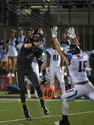 Ventura quarterback Jack Gutierrez throws a pass over Camarillo's Kolby Dowling during Friday night's thrilling game at Ventura High.