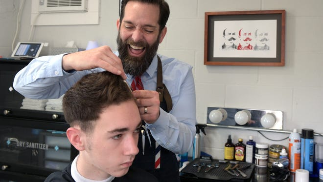 Jars of Clay guitarist and vocalist Stephen Mason cuts Eyan Bonner's hair at Mason's new Nashville barbershop, The Handsomizer, on March 12.