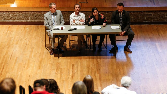 Panelists (from left) David Mitchell, Brant Cunningham, Mae Quinn and Nick Schroer make their case for raising Missouri's criminal prosecution age from 17 to 18 during a discussion at Missouri State University on Tuesday, Dec. 5, 2017.