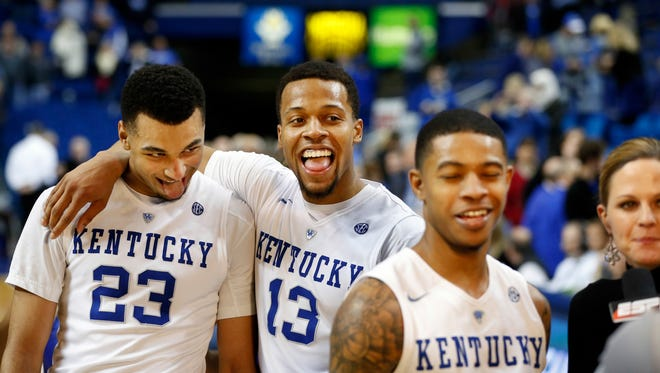 Kentucky's Jamal Murray (#23) and Isaiah Briscoe photobomb teammate Tyler Ulis during an interview with ESPN. 