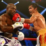 Manny Pacquiao lands a punch to bring down Timothy Bradley at MGM Grand Garden Arena on Saturday.