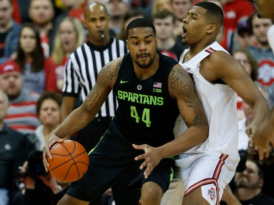 Michigan State forward Nick Ward, left, drives against Ohio State forward Kaleb Wesson during the second half of an NCAA college basketball game in Columbus, Ohio, Saturday, Jan. 5, 2019. Michigan State won 86-77. (AP Photo/Paul Vernon)