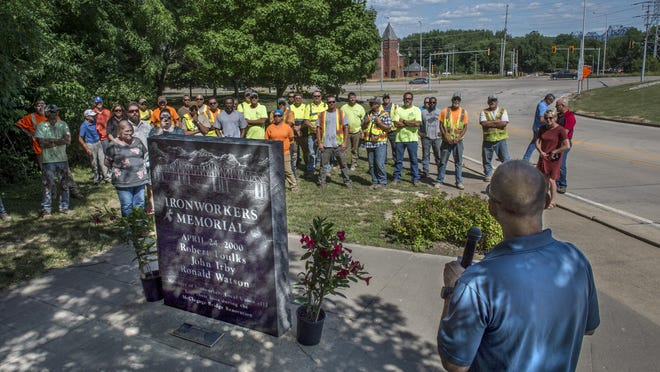 Ironworkers Local 112 business manager Jason Emerick addresses ironworkers gathered Thursday, June 25, 2020 at the Ironworkers Memorial on Lorentz Street in Peoria. The gathering was to recognize the 20th anniversary of a construction accident during a 2000 repair project on the McClugage Bridge, barely visible above the treelike at right,  that took the lives of three ironworkers, Robert Foulks and Ronald Watson, both of Peoria, and John Irby, of Lacon, and injured two others when scaffolding the men were working on collapsed, dropping the men to the Illinois River below. DAVID ZALAZNIK/JOURNAL STAR