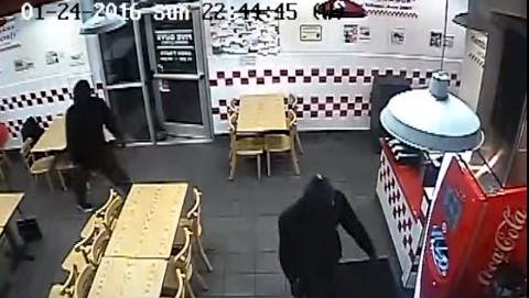 A still image taken from surveillance footage during the robbery of the Five Guy's on Youree Drive.