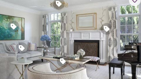 Retailer Wayfair's web site offers several concepts to selling, including rooms by a designer. When you run your cursor over the photo, price tags come into view. Click on them to see how much each piece costs.