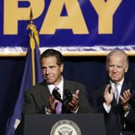 New York Gov. Andrew Cuomo and Vice President Joe Biden applaud at a labor rally, Thursday, Sept. 10, 2015, in New York. Cuomo is proposing that the state minimum wage be raised to $15 an hour. (AP Photo/Mark Lennihan)