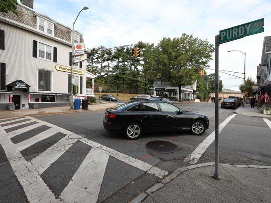 Vehicles pass through the intersection of Purchase