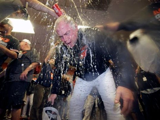 Members of the Baltimore Orioles pour beer and champagne on manager Buck Showalter after clinching the American League East title last season. If the Orioles want to win another AL East title, they have some important decisions to make over the next couple weeks.