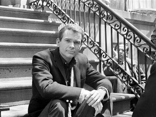 Actor Dean Jones poses on steps.