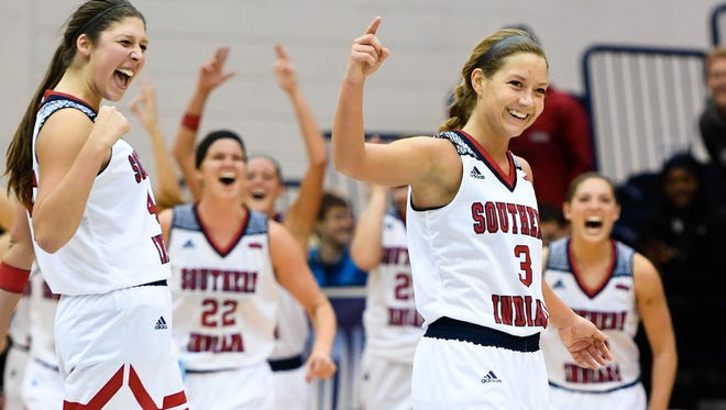 Randa Harshbarger (3) reacts with her teammates after she hit a last second shot from behind half court to finish the half up 46-21 as the University of Southern Indiana women play the Kentucky State Thorobreds at the PAC arena Wednesday, December 7, 2016.