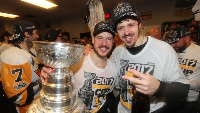 Evgeni Malkin, left, and Sidney Crosby have each won three Stanley Cup titles with the Penguins, including two in a row.