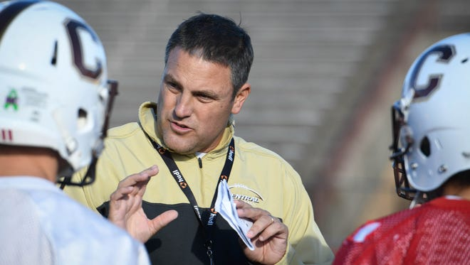 Former Central High School football coach Andy Owen talks with his players during practice last season. Owen will coach the South team in the annual IFCA North-South All-Star game Friday.