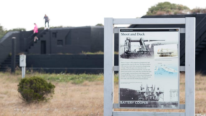 Tourists check out the remains of Battery Cooper near Fort Pickens in Pensacola on Monday, December 4, 2017.  Lead from munitions once used at a firing range just east of the battery are among contaminants needing to be addressed at current and former military sites according to a recent report.
