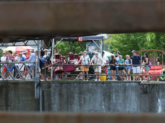 A crowd gathers waiting for the Lift Bridge to come down after boats went by on the Erie Canal.