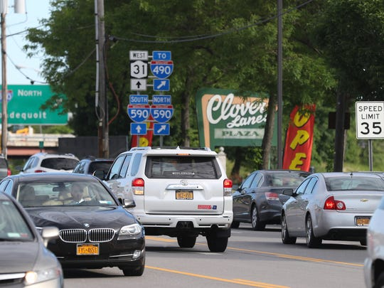Early morning traffic flows on the Monroe Avenue in