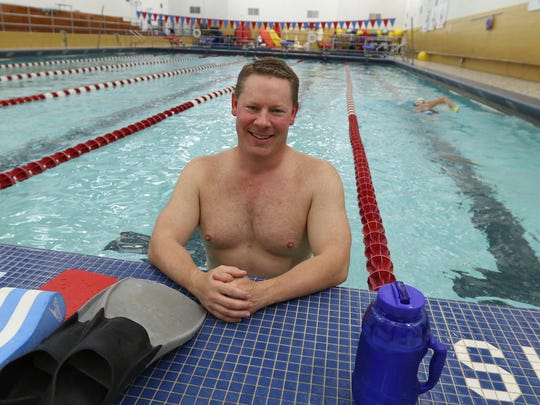 Scott Doescher, 47, of Brighton works out with the Fairport Masters team at the pool at Fairport High School. He is heading to Portland, Oregon, for the U.S. Masters Swimming National Championship.