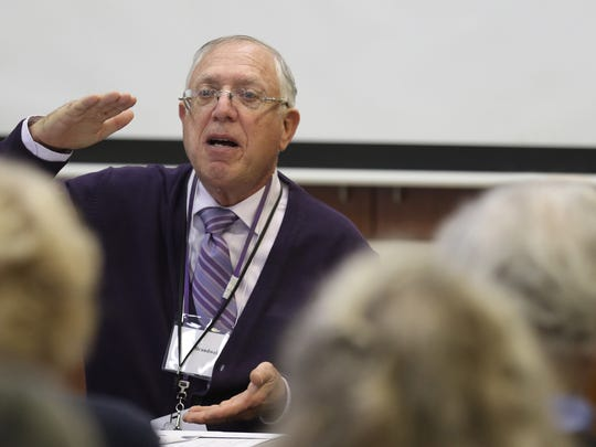Ronald Brandwein with Lifespan goes over information during one of his Medicare 101 sessions in 2016.