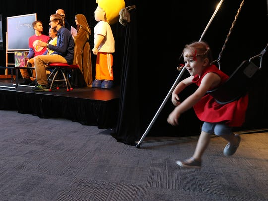 The swing, Dungeons & Dragons and Fisher-Price Little People were inducted Thursday into the National Toy Hall of Fame. Ainsley Jacus, 4, of Brighton was the model for the swing during the announcement.