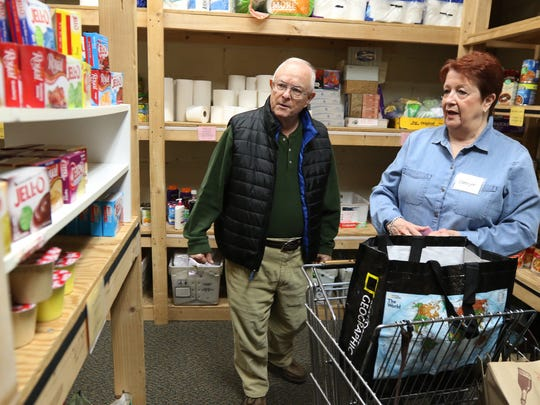 Brent Grattan of Rochester and volunteer Carolyn Nally of Pittsford go through and pick out items he needs at the Pittsford Food Cupboard.  The food cupboard assists approximately 300 households a month from six ZIP code areas that cover Pittsford, Brighton, East Rochester and Rochester. The food cupboard is open Tuesdays and Fridays from 9:30 a.m. to 1:30 p.m. and the first and third Saturdays of the month from 9:30 to 11:30 a.m.