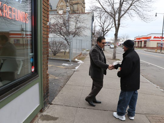 Roberto Burgos bought a building at 821 North Clinton and has been active in business initiatives in the area and keeping a watch for illegal drug use.  Raul Soto, who lives nearby and knows one of Burgos' tenants, stopped to chat after recognizing Burgos.