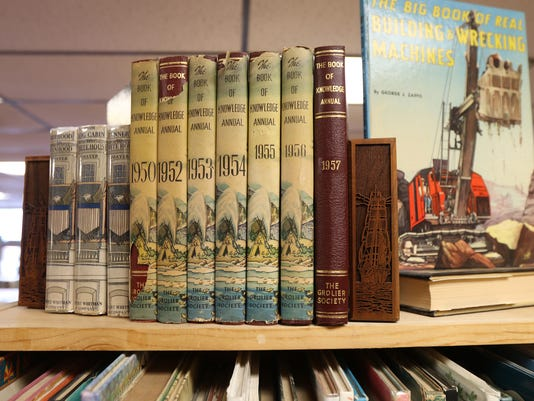 636233704325767990-TY-0217-OLD-BOOKS-SMALL-WORLD.jpg