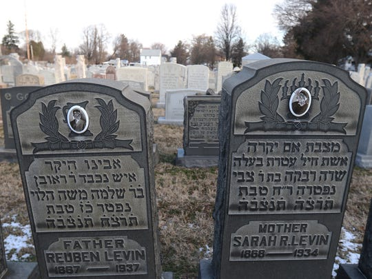 Reuben and Sarah Levin's photos on the gravestones had their faces scratched out at Waad Hakalel Cemetery in Rochester.