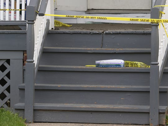 Rochester police are still investigating 52 Dayton Street on Tuesday where a body of a man was found on Saturday, May 13.  A box of gloves and tape block off the stairs of the residence.