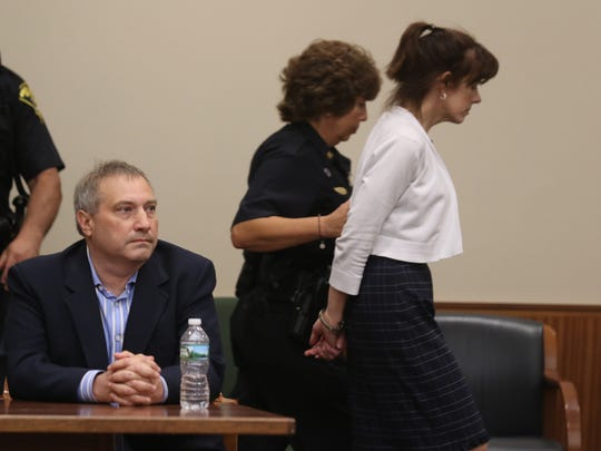 Paul Tucci sits waiting to hear what the judge is going to say while Laura Rideout is led out of the courtroom to jail after sentencing.