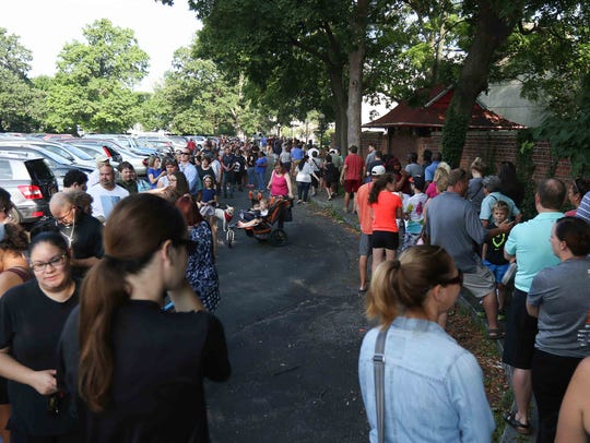 Long lines formed and looped in the parking lot of