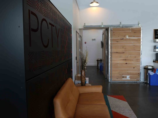 Dutton Properties works with businesses to help design and build their space.  The custom structure with Paylocity's stock initials and the sliding doors were made specifically for Paylocity Corporation.