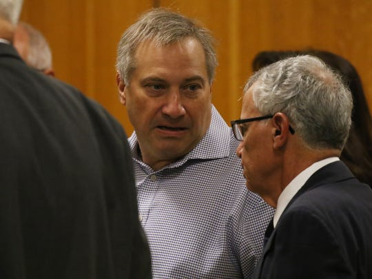 Paul Tucci, Laura Rideout's boyfriend, arrives for her sentencing.  He was talking with her attorney, Michael DiPrima, before sentencing.