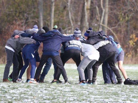 The Watkins Glen boys cross country team huddles before