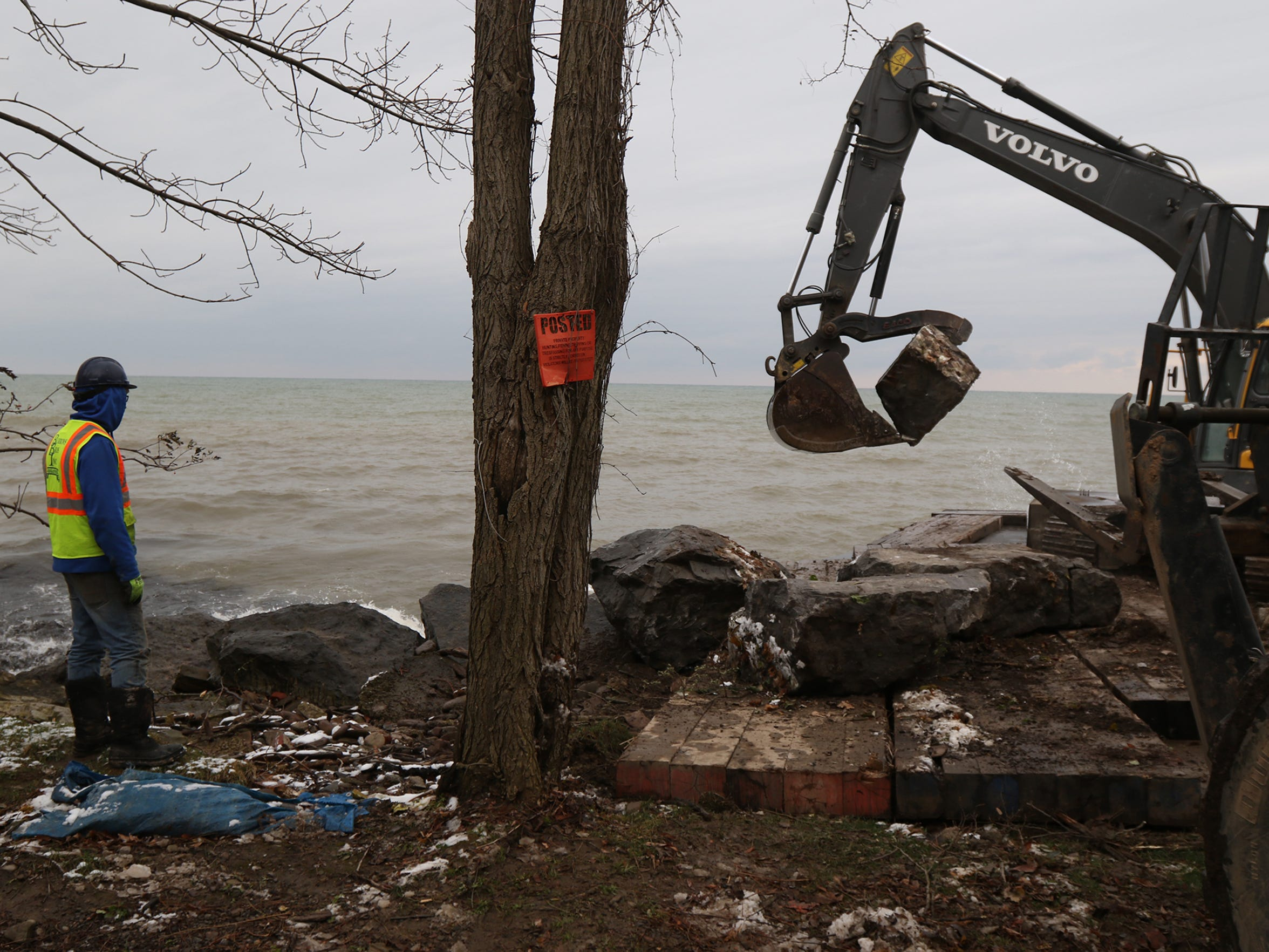 Work before winter comes continues on a breakwall at Oklahoma Beach in Webster.