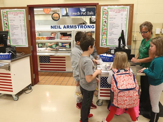 Karen Higgins works the register at Gates Chili's Neil Armstrong Elementary School as students use their accounts to buy breakfast.