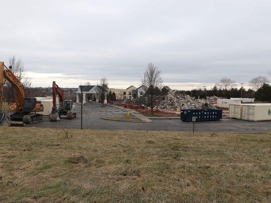 A pile of rubble is left behind after a Feb. 18, 2018 fire at the former Country Inns and Suites at 4625 West Henrietta Road.