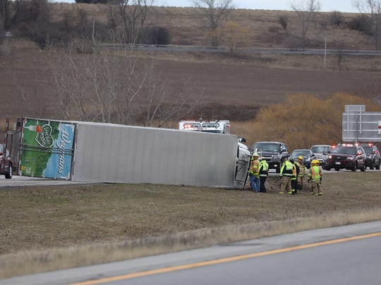 A Wegmans tractor-trailer got pushed by a gust of wind and flipped over, ending up blocking a portion of Interstate 390 north at exit 12.