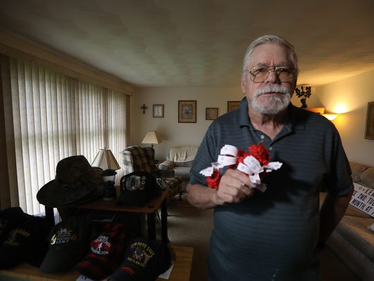 Joe Jakus of Henrietta is a life member the VFW Post 5465.  He is not allowed to offer poppies to people outside the U.S. Post Office in Henrietta.