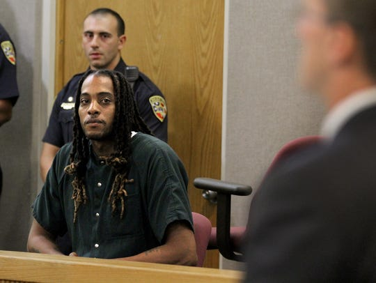 Michael Taylor listens in Superior Court Judge Paul