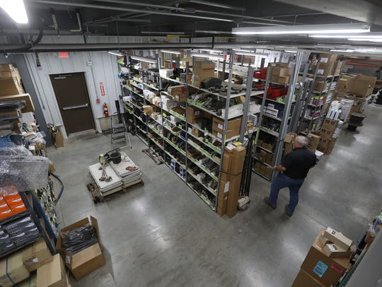 Jamie Wojtusiak heads down an aisle to look for a part at Marquart Repair and Equipment Sales. The Marquarts own a total of eight businesses, with New York Chips being their newest.