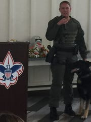 Officer Shannon Snook with her canine partner, Basilone