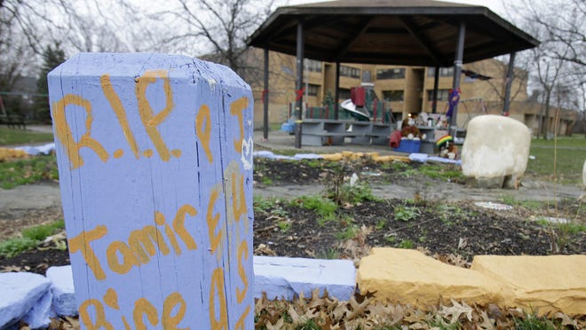 """""""R.I.P. Tamir Rice"""" is written on a block of wood near a memorial in Cleveland. A letter writer says a grand jury decision not to criminally indict the two officers in Tamir's killing has shaken his faith in the justice system."""