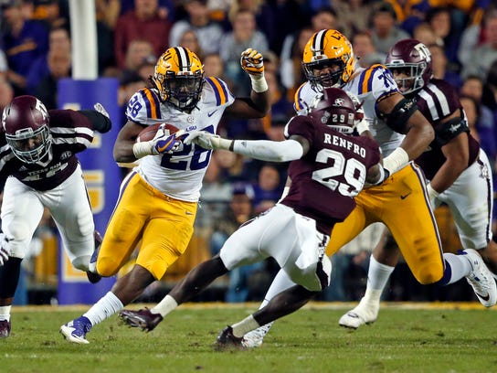 LSU running back Darrel Williams (28) carries against Texas A&M defensive back Debione Renfro (29) during the first half of an NCAA college football game in Baton Rouge, La., Saturday, Nov. 25, 2017. (AP Photo/Gerald Herbert)