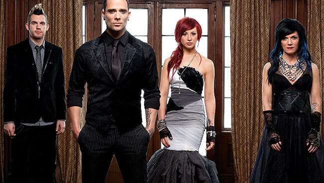 Skillet currently consists of husband and wife John (lead vocals, bass) and Korey Cooper (rhythm guitar, keyboards, backing vocals), along with Jen Ledger (drums, vocals) and Seth Morrison (lead guitar).