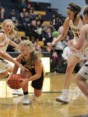 Cascade's Emma Woods corrals the ball in the lane against Stayton on Friday, Jan. 19, 2018.