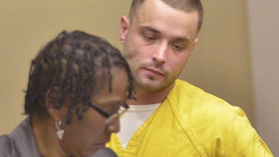 Mark Hontz listens to his attorney, Sharon Clark Woodside,